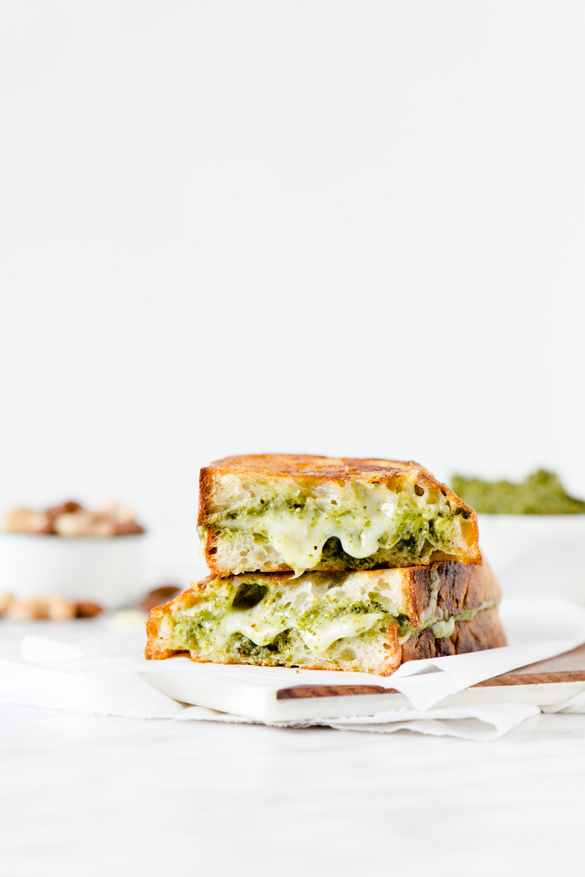Pesto & Gouda Grilled Cheese - Gooey, herby goodness, sandwiched between two fresh pieces of sourdough bread.