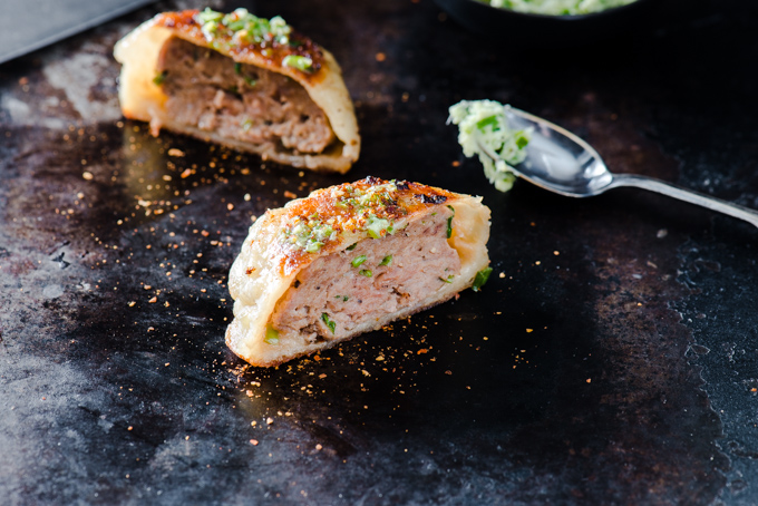 Pork Meat Pies with Scallion Butter - It's hard to put into words, how amazing these were. Dough made from scratch, juicy pork filling, finished with scallion butter.